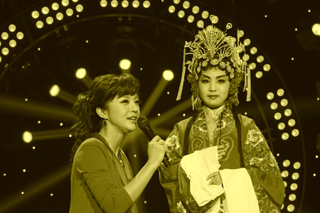 liu: LUANNAN COUNTY - JANUARY 6: The CCTVs Opera channel presenter liu chang and actors on the stage, in the ChengZhaoCai grand theater, January 6, 2014,luannan county, hebei province, china.