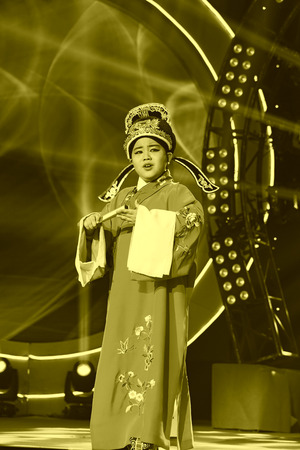 stage props: LUANNAN COUNTY - JANUARY 4: The boy singing PingJu on the stage, in the ChengZhaoCai grand theater, January 4, 2014,luannan county, hebei province, china. Editorial