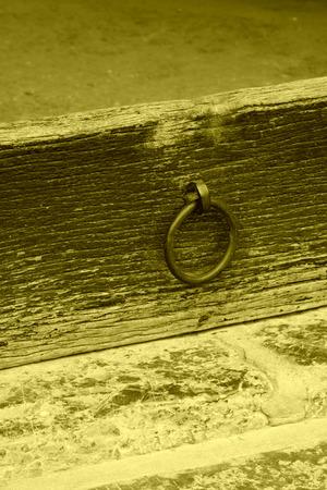 threshold: Black metal ring on the threshold, closeup of photo