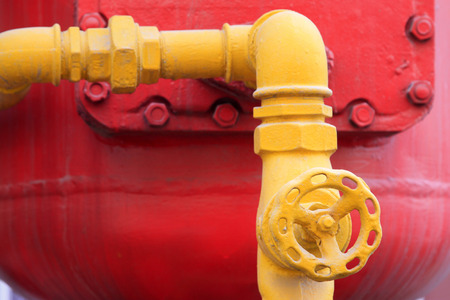 red metal: Red metal parts and yellow line, closeup of photo Stock Photo