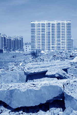 tsunamis: \Housing demolition materials in the demolition site and new building