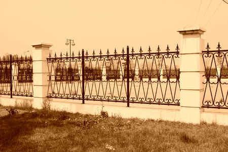 weed block: metal fence and wall battlements in a park, china Stock Photo