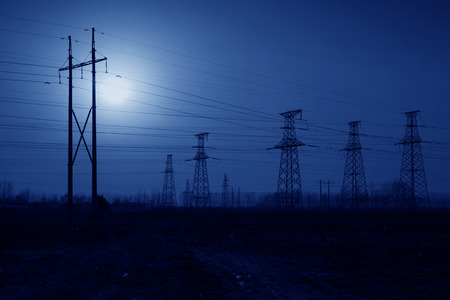 electric power: electric tower in the evening sky, power transmission facilities