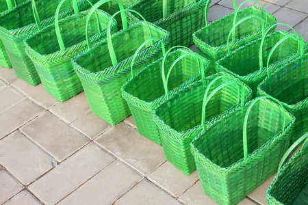 lining up: Green plastic basket lining up on floor Stock Photo