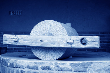 millstone: Ancient Chinese tools used for grinding wheat, in Chinese rural areas