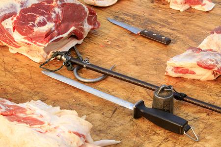 steelyard: pork and steelyard knife, closeup of photo Editorial