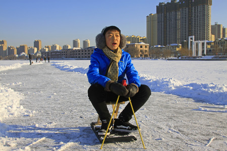 january 1: LUANNAN COUNTY - JANUARY 1: People skating on the ice surface, on January 1, 2015, Luannan County, Hebei Province, China