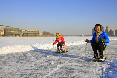 ice surface: LUANNAN COUNTY - JANUARY 1: People skating on the ice surface, on January 1, 2015, Luannan County, Hebei Province, China
