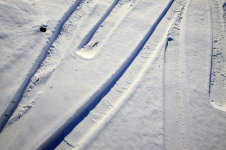 compaction: wheel trace in the snow, closeup of photo