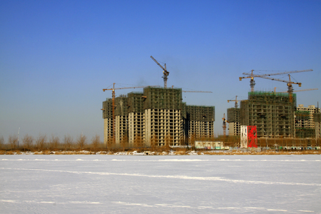 uncompleted: Unfinished buildings in the snow, in northern China