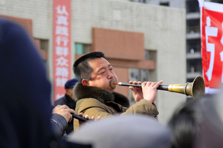 unrestrained: LUANNAN COUNTY - FEBRUARY 27: traditional Chinese style Suona performance in the square, on February 27, 2015, Luannan County, Hebei province, China