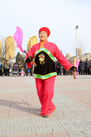 unrestrained: LUANNAN COUNTY - FEBRUARY 27: traditional Chinese style yangko dance performances in the square, on February 27, 2015, Luannan County, Hebei province, China Editorial