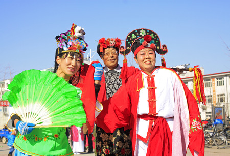 ms: LUANNAN COUNTY - MARCH 1: traditional Chinese style yangko dance performances in the square, on march 1, 2015, Luannan County, Hebei province, China