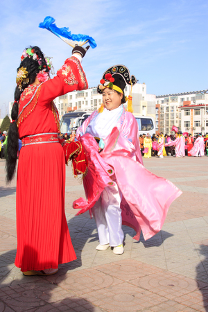 ms: LUANNAN COUNTY - MARCH 4: traditional Chinese style yangko dance performances in the square, on march 4, 2015, Luannan County, Hebei province, China
