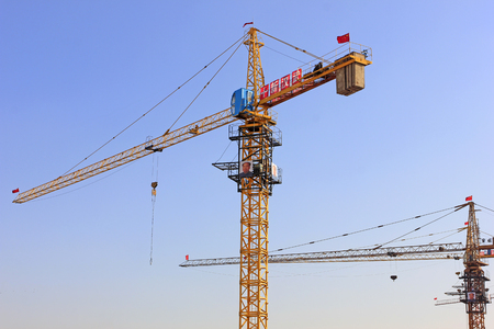 mao: LUANNAN COUNTY - JANUARY 31: MAO zedongs portrait posted on the tower crane, January 31, 2015, Luannan County, Hebei province, China Editorial