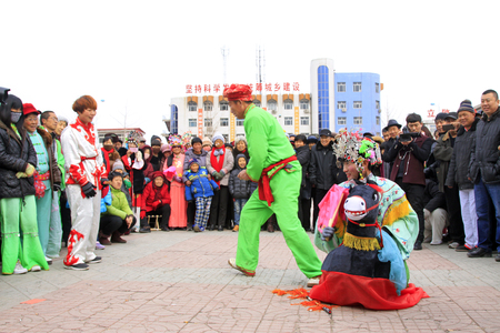 LUANNAN COUNTY - FEBRUARY 27: traditional Chinese style yangko dance performances in the square, on February 27, 2015, Luannan County, Hebei province, China Editorial