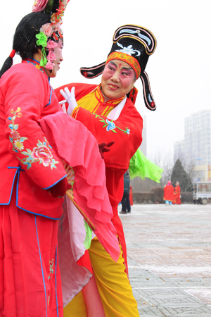 unrestrained: LUANNAN COUNTY - FEBRUARY 28: traditional Chinese style yangko dance performances in the square, on February 28, 2015, Luannan County, Hebei province, China
