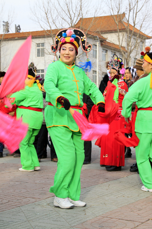 hankie: LUANNAN COUNTY - FEBRUARY 27: traditional Chinese style yangko dance performances in the square, on February 27, 2015, Luannan County, Hebei province, China Editorial