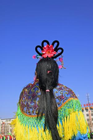 customs and celebrations: traditional Chinese style yangko headwear, closeup of photo