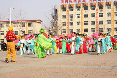 customs and celebrations: LUANNAN COUNTY - MARCH 6: traditional Chinese style yangko dance performances in the square, on march 6, 2015, Luannan County, Hebei province, China