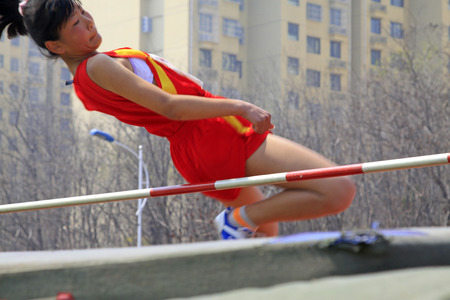 obscurity: LUANNAN COUNTY - APRIL 14: Womens high jump event at the athletics meeting, April 14, 2015, Luannan County, Hebei Province, China