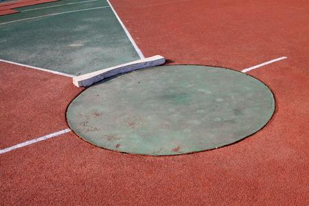lancio del peso: shot put area in the stadium, closeup of photo