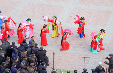 customs and celebrations: LUANNAN COUNTY - FEBRUARY 26: people watching a Chinese traditional style yangko dance in the square, on February 26, 2015, Luannan County, Hebei province, China