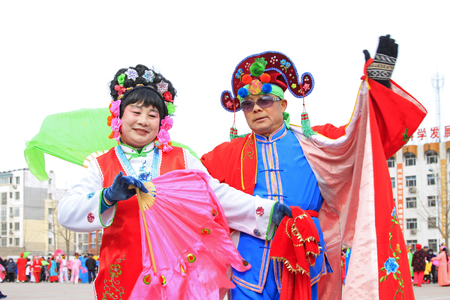 customs and celebrations: LUANNAN COUNTY - FEBRUARY 27: traditional Chinese style yangko dance performances in the square, on February 27, 2015, Luannan County, Hebei province, China Editorial
