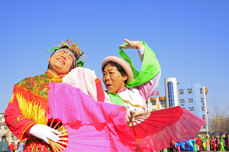 beat women: LUANNAN COUNTY - MARCH 1: traditional Chinese style yangko dance performances in the square, on march 1, 2015, Luannan County, Hebei province, China