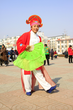 customs and celebrations: LUANNAN COUNTY - MARCH 2: traditional Chinese style yangko dance performances in the square, on march 2, 2015, Luannan County, Hebei province, China Editorial