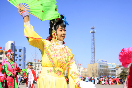 unrestrained: LUANNAN COUNTY - MARCH 3: traditional Chinese style yangko dance performances in the square, on march 3, 2015, Luannan County, Hebei province, China