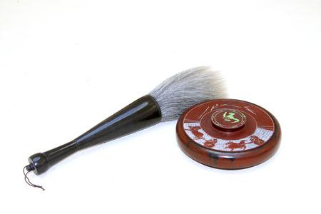 inkstone: inkstone and writing brush on a white background, closeup of photo