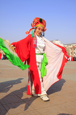 unrestrained: LUANNAN COUNTY - MARCH 2: traditional Chinese style yangko dance performances in the square, on march 2, 2015, Luannan County, Hebei province, China Editorial