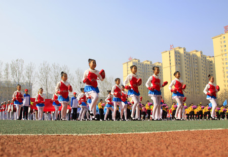 LUANNAN COUNTY - APRIL 14: Group gymnastic performance at the athletics meeting, April 14, 2015, Luannan County, Hebei Province, China