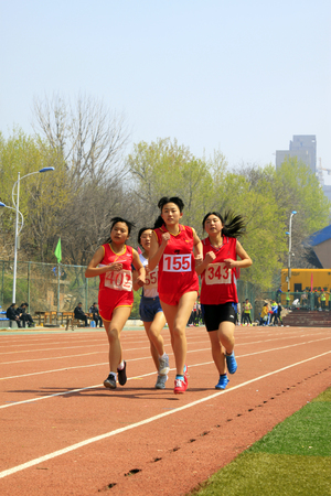 obscurity: LUANNAN COUNTY - APRIL 14: Womens 100 meter race scene at the athletics meeting, April 14, 2015, Luannan County, Hebei Province, China Editorial