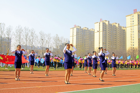 gym dress: LUANNAN COUNTY - APRIL 14: Group gymnastic performance at the athletics meeting, April 14, 2015, Luannan County, Hebei Province, China