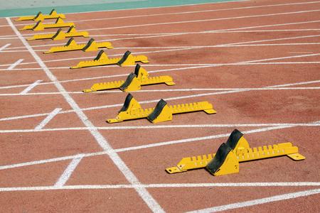 starting block: yellow starting block and athletes