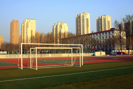 health facility: LUANNAN COUNTY - APRIL 14: Football field in a high school on the playground, April 14, 2015, Luannan County, Hebei Province, China