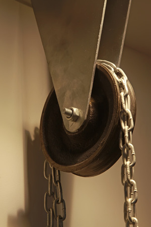 pulley: pulley and chains, closeup of photo