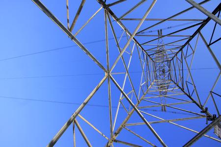 energia electrica: Electric power tower bottom view, closeup of photo Foto de archivo