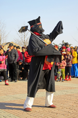 witty: LUANNAN COUNTY - MARCH 1: traditional Chinese style yangko dance performances in the square, on march 1, 2015, Luannan County, Hebei province, China