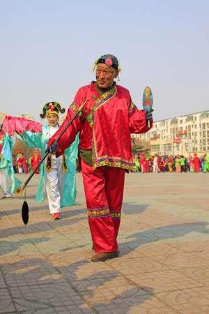 greatcoat: LUANNAN COUNTY - MARCH 6: traditional Chinese style yangko dance performances in the square, on march 6, 2015, Luannan County, Hebei province, China