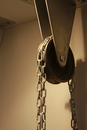 light chains: pulley and chains, closeup of photo
