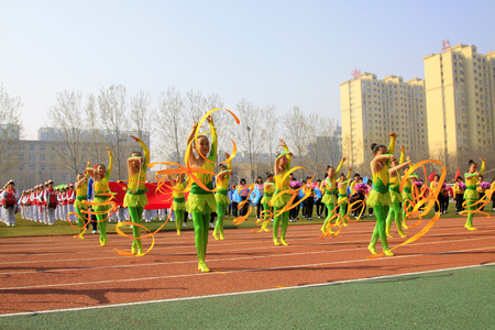 calisthenics: LUANNAN COUNTY - APRIL 14: Group gymnastic performance at the athletics meeting, April 14, 2015, Luannan County, Hebei Province, China