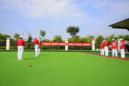 athletic wear: LUANNAN COUNTY - AUGUST 29: Chinese gate ball match scene, on August 29, 2015, Luannan County, Hebei Province, China.