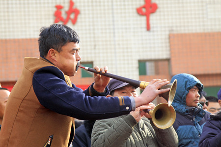 customs and celebrations: LUANNAN COUNTY - FEBRUARY 27: traditional Chinese style Suona performance in the square, on February 27, 2015, Luannan County, Hebei province, China