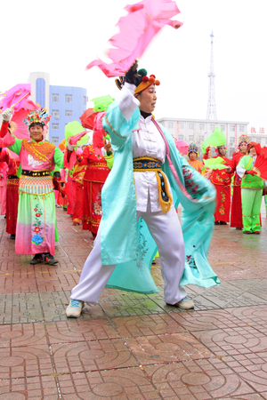 customs and celebrations: LUANNAN COUNTY - FEBRUARY 28: traditional Chinese style yangko dance performances in the square, on February 28, 2015, Luannan County, Hebei province, China