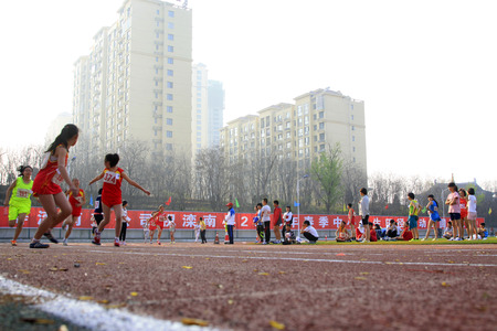 obscurity: LUANNAN COUNTY - APRIL 14: 400 meter relay runner at the sports meeting, April 14, 2015, Luannan County, Hebei Province, China