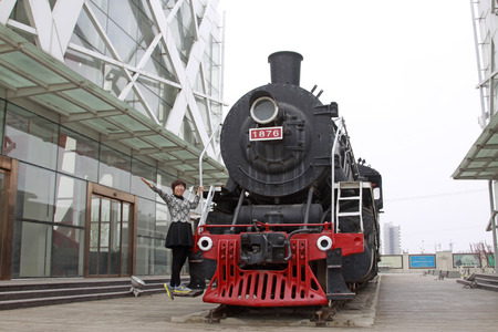 tangshan city: TANGSHAN CITY - APRIL 18: A lady in the old steam engine, April 18, 2015, Tangshan City, Hebei Province, China Editorial