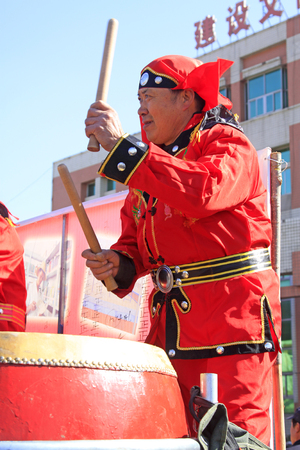 customs and celebrations: LUANNAN COUNTY - MARCH 3: traditional Chinese style yangko dance performances in the square, on march 3, 2015, Luannan County, Hebei province, China